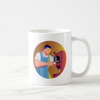 trade factory worker working with drill press coffee mugs