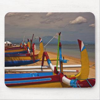 Traditional Balanese fishing boats on beach near Mouse Pad