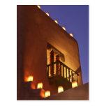 Traditional farolitos light up adobe structures 2 post card