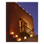 Traditional farolitos light up adobe structures 2 poster