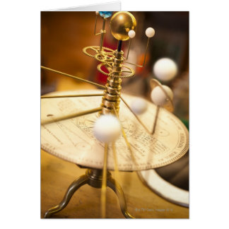 Traditional handcrafted brass orrery with the card