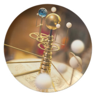Traditional handcrafted brass orrery with the dinner plates