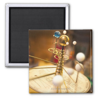 Traditional handcrafted brass orrery with the fridge magnets