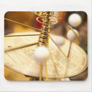 Traditional handcrafted brass orrery with the mouse pad