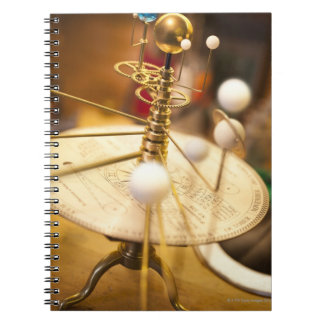 Traditional handcrafted brass orrery with the notebook
