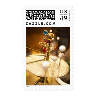 Traditional handcrafted brass orrery with the postage stamp