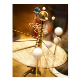 Traditional handcrafted brass orrery with the postcard