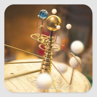 Traditional handcrafted brass orrery with the square sticker