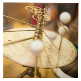 Traditional handcrafted brass orrery with the tile
