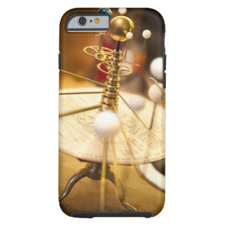 Traditional handcrafted brass orrery with the tough iPhone 6 case