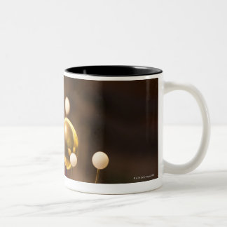 Traditional handcrafted brass orrery with the Two-Tone coffee mug