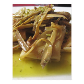 Traditional italian Paccheri pasta with artichokes Letterhead