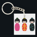 "Traditional Japanese Kokeshi Geisha Dolls Keychain<br><div class=""desc"">A beautiful and colorful cartoon depiction of traditional Kokeshi Japanese dolls,  perfect for any lover of Japanese culture. This image is available here: https://pixabay.com/en/japanese-kokeshi-doll-white-937706/.</div>"