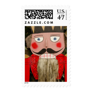 Traditional nutcracker Christmas decoration. Postage