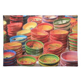 Traditional pottery on a local market cloth placemat