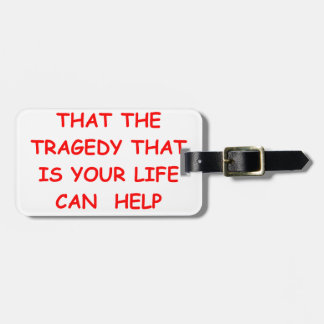TRAGEDY TRAVEL BAG TAG