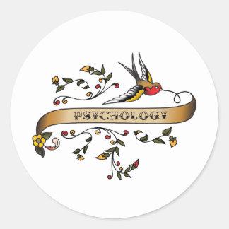 Trago y voluta con psicología etiquetas redondas