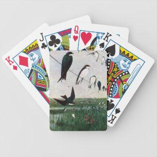 Tragos en una línea eléctrica barajas de cartas