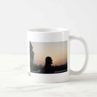 Trague la taza de café de Sun
