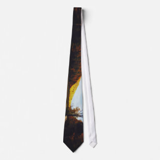 Trail along water and autumn trees tie