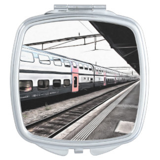 Train at station in Switzerland Compact Mirror