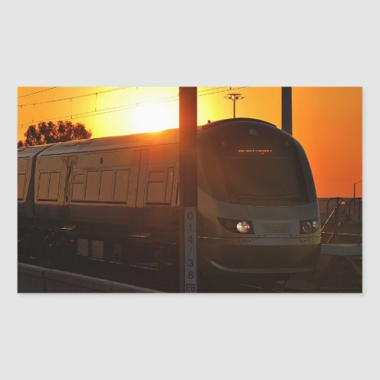Train at sunset rectangular sticker