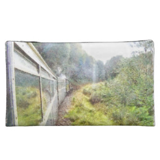 Train heading through greenery makeup bag