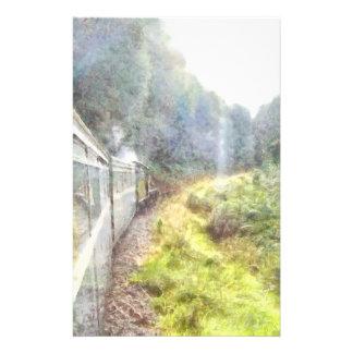 Train heading through greenery stationery
