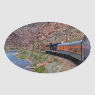 Train in Canyon Background Oval Sticker