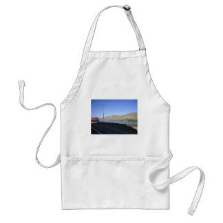 Train on tracks along water adult apron