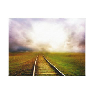 train tracks in middle of green land canvas print