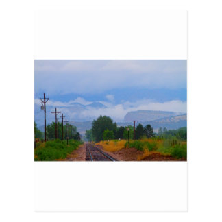 Train Tracks into the Rocky Mountain Low Clouds Postcard