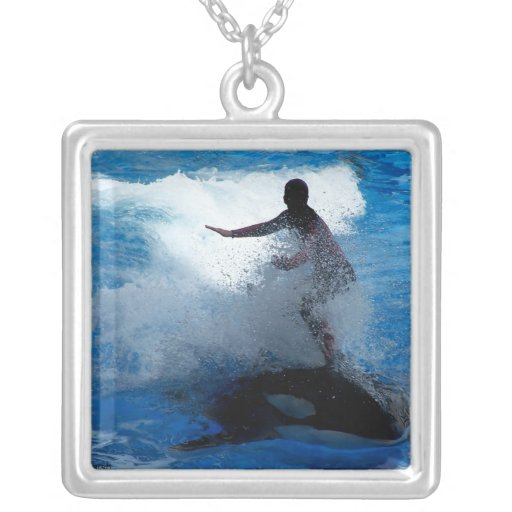 Trainer riding on killer whale orca photograph necklace