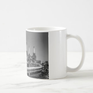 Trains pass Battersea Power Station, London Coffee Mug