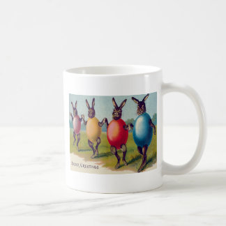 Traje coloreado del huevo del conejito de pascua taza de café