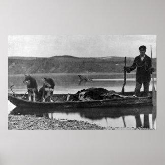 Trampero en canoa con las pieles y los perros Alas Impresiones