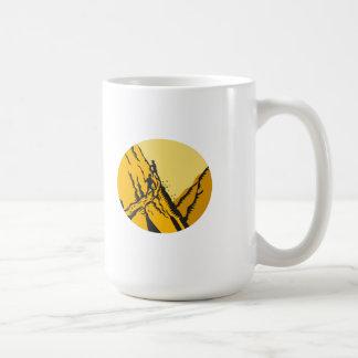 Trampers Climbing Steep Path Mountain Oval Woodcut Coffee Mug