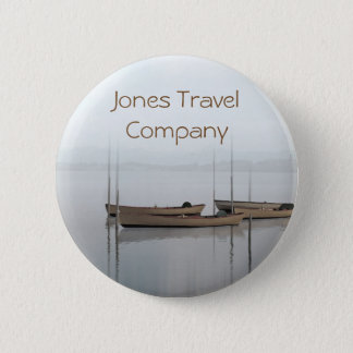 Tranquil boats in a still bay travel company pinback button