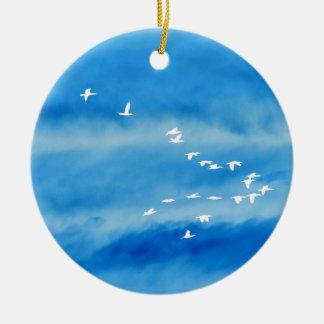 Tranquil Silhouette of Birds in Flight Ceramic Ornament