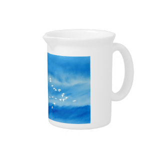Tranquil Silhouette of Birds in Flight Drink Pitcher