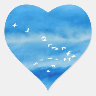 Tranquil Silhouette of Birds in Flight Heart Sticker