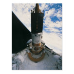 Transbordador espacial que lanza el satélite tarjeta postal
