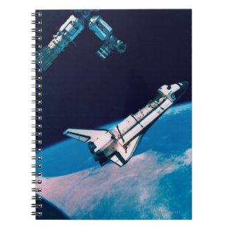 Transbordador espacial y estación en órbita notebook