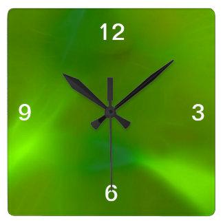 Translucent green wall clocks
