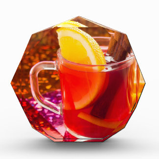 Transparent cup of tea with citrus, cinnamon award