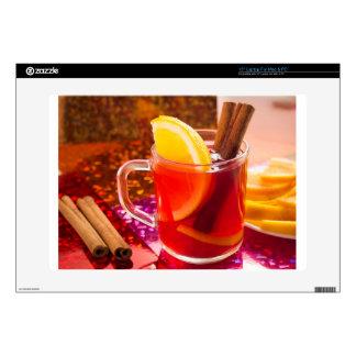 Transparent cup of tea with citrus, cinnamon laptop skin