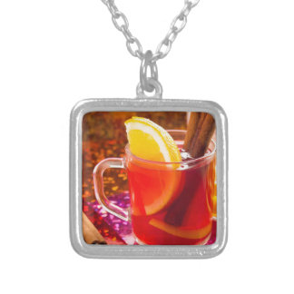 Transparent cup of tea with citrus, cinnamon silver plated necklace