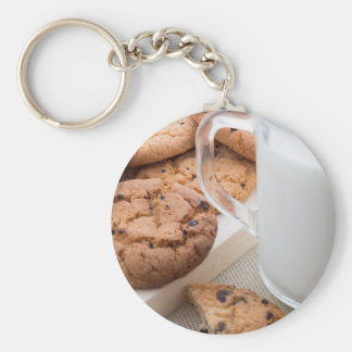 Transparent cup with milk and oatmeal cookies keychain