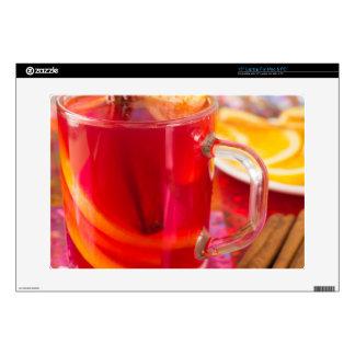 Transparent mug with citrus mulled wine, cinnamon skin for laptop