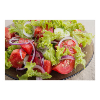 Transparent plate with vegetable salad closeup poster